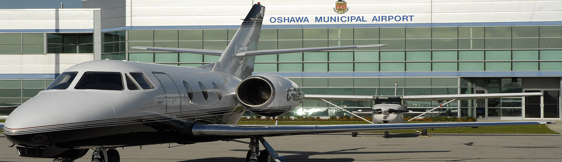 Planes stand on the tarmac outside the Oshawa Municipal Airport