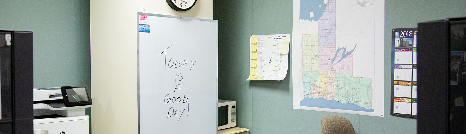 "A whiteboard in an office with ""Today is a good day!"" written on it"