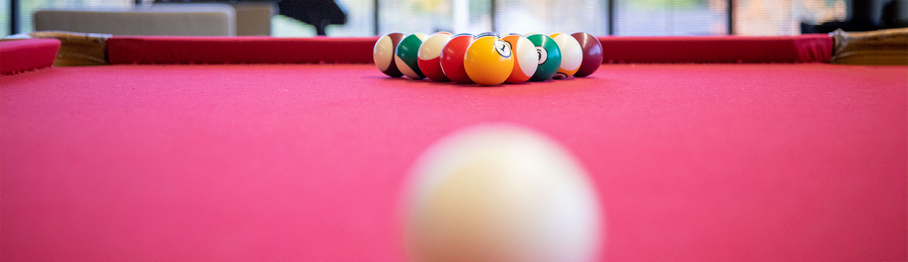 Billiard balls set up on a red billards table