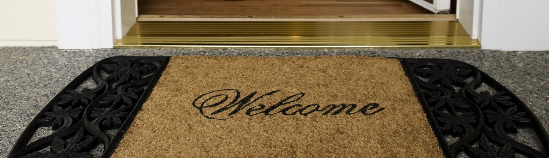 A front door with a welcome mat
