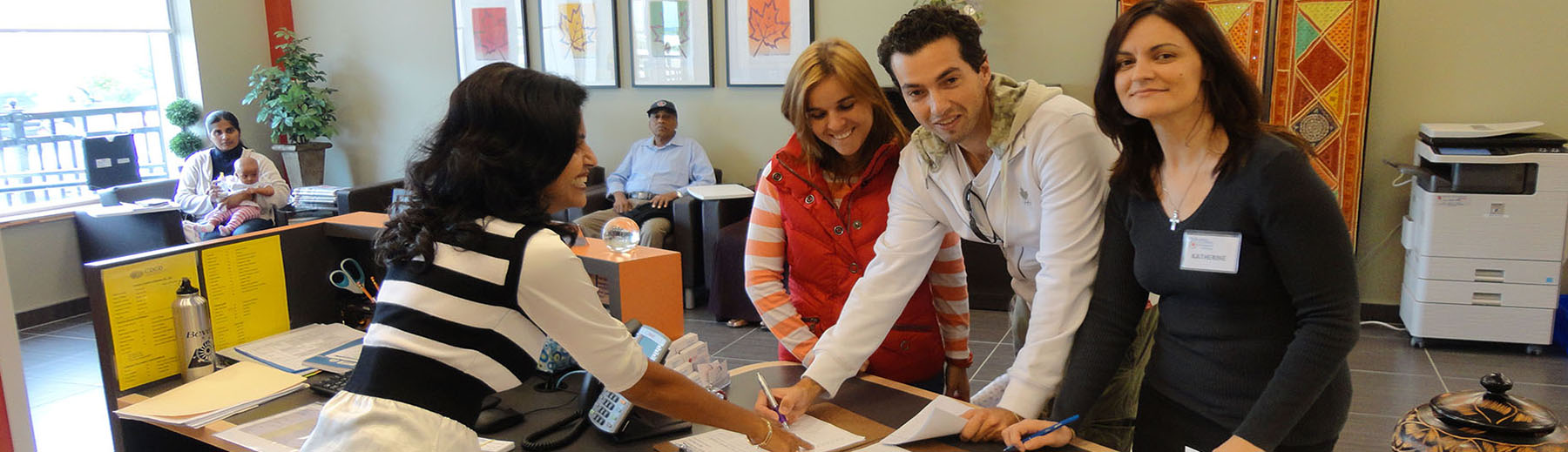 Newcomers register at the reception desk at the Ajax Welcome Centre
