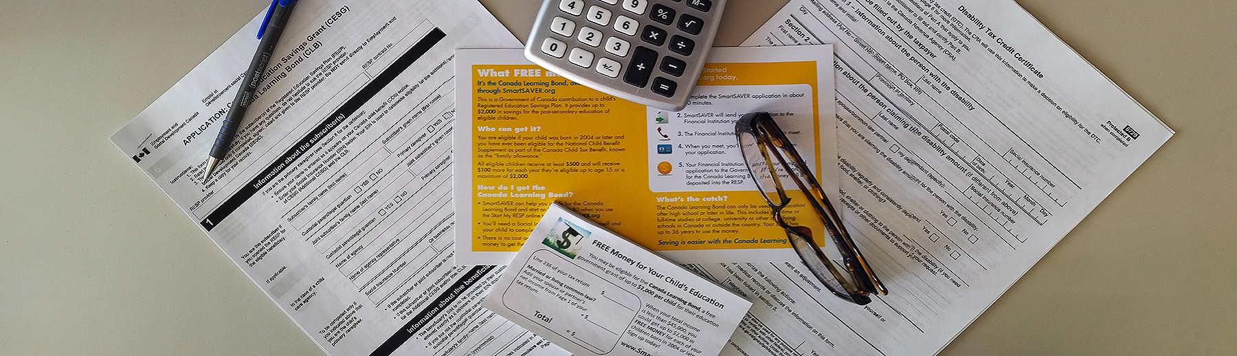 Tax papers on a desk with a calculator