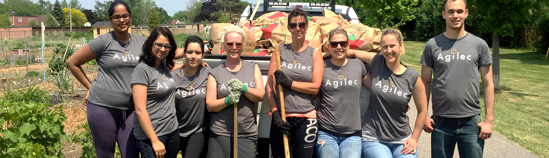 Staff from Agilec volunteer at a community clean-up